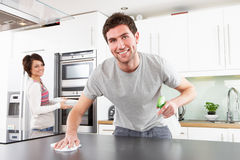 Young Couple Cleaning Modern Kitchen Stock Photos