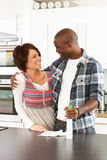 Young Couple Cleaning Modern Kitchen Stock Photo