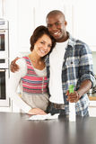 Young Couple Cleaning Modern Kitchen Royalty Free Stock Photo