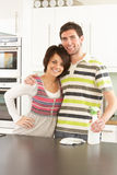 Young Couple Cleaning Modern Kitchen Stock Image