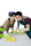 Young couple cleaning a table Royalty Free Stock Photography