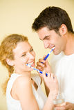 Young couple cleaning teeth Stock Photos