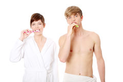 Young couple cleaning teeth together. Stock Image