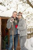 Young Couple Clearing Snow From Path Royalty Free Stock Photo