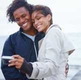 Young couple clicking their snap Royalty Free Stock Image