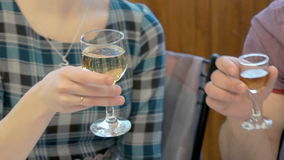 Young couple clink glasses champagne and brandy stock video footage