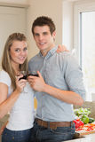 Young couple clinking wine glasses Royalty Free Stock Photography