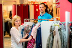 Young couple in the clothes shop Royalty Free Stock Photos
