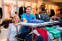 Young couple in the clothes shop Royalty Free Stock Photo