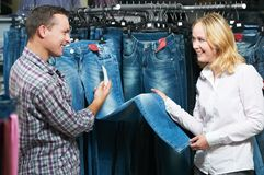 Young couple at clothes shopping Royalty Free Stock Photos