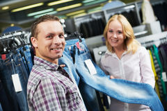Young couple at clothes shopping Royalty Free Stock Images