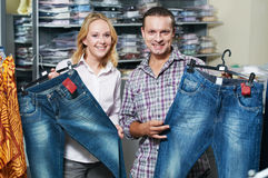 Young couple at clothes shopping Royalty Free Stock Photography