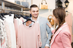 Young couple in clothing store Stock Image
