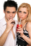Young couple with cocktails. Isolated Stock Photo