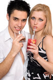 Young couple with cocktails. Isolated Royalty Free Stock Images
