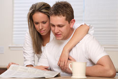 Young couple, coffee newspaper Stock Image