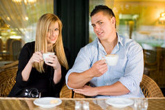 Young couple at coffee shop. Royalty Free Stock Images
