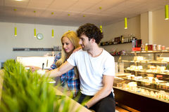 Young couple in a coffee shop Royalty Free Stock Photography