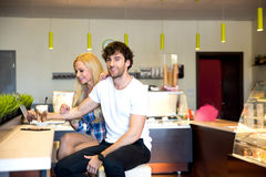 Young couple in a coffee shop Stock Image