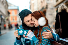Young couple with coffee in winter outside Royalty Free Stock Photos