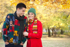 Young couple in cold autumn park Stock Image