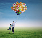 Young couple with colorful balloons Royalty Free Stock Photo
