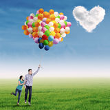 Young couple with colorful balloons Stock Photos