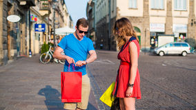 Young couple with colorful shopping bags. Argument. Royalty Free Stock Image