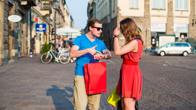 Young couple with colorful shopping bags. Argument. Royalty Free Stock Images