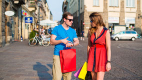 Young couple with colorful shopping bags. Argument. Stock Photography