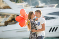Young couple with colourful balloons in town. Stock Photo
