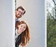 Young couple in column Stock Photos