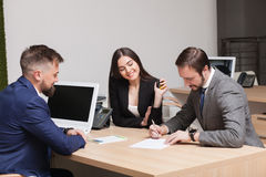 Young couple commits to buying and signing papers Stock Photography
