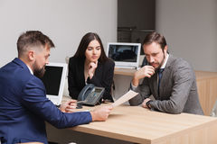 Young couple commits to buying and signing papers Stock Photos