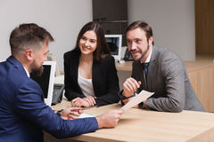 Young couple commits to buying and signing papers Royalty Free Stock Photo