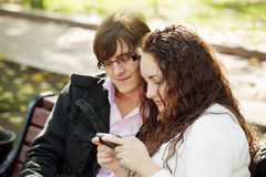 Young couple with communicator Royalty Free Stock Photography
