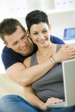 Young couple with computer Stock Photography