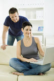 Young couple with computer Stock Images