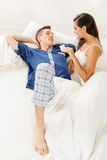Young Couple With Condom Royalty Free Stock Photo