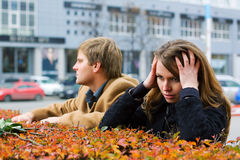 Young fashion couple in conflict on a city street Royalty Free Stock Photos