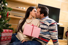 Young couple congratulates each other Merry Christmas Stock Photos
