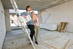 Young couple on construction site Stock Photos
