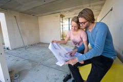 Young couple on construction site Royalty Free Stock Images