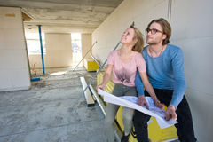 Young couple on construction site Stock Image