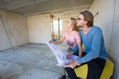 Young couple on construction site Stock Photography
