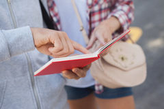 Young couple consulting the guide book Royalty Free Stock Images