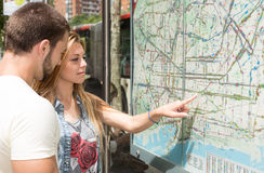 Young couple consulting a map Stock Photos