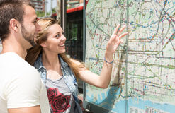 Young couple consulting a map Royalty Free Stock Image