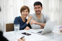 Young couple consulting with professional consultant. Happy Young couple consulting with professional consultant stock image