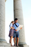 Young couple consults a map while on holiday Royalty Free Stock Photography